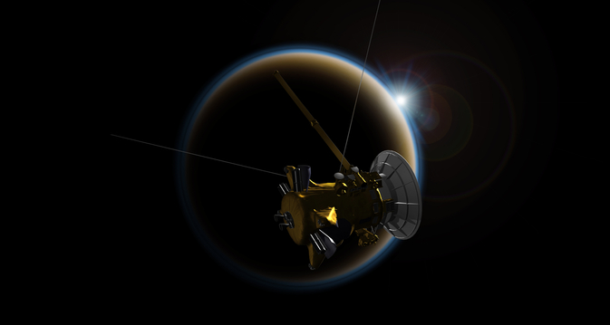 Satellite crossing in front of Saturn's moon, Titan.