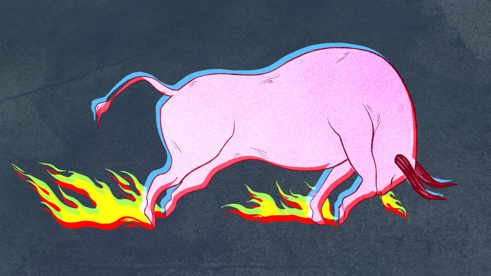 A pink bull standing in fire