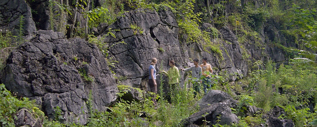 People standing by a cliff