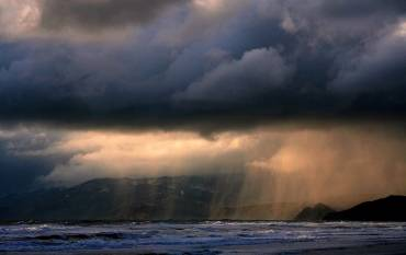 Rain over San Francisco, photo by Brocken Inaglory