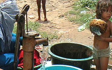 Mother and child at water pump