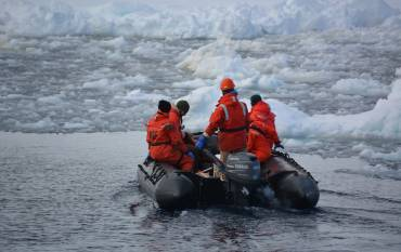 Scientists on a zodiac in West Antarctic Peninsula