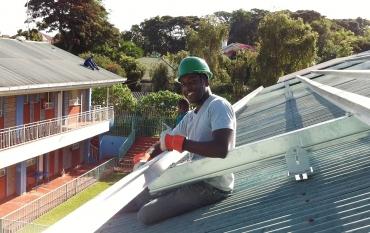 Samuel Adeyemo installing a solar system in Kenya