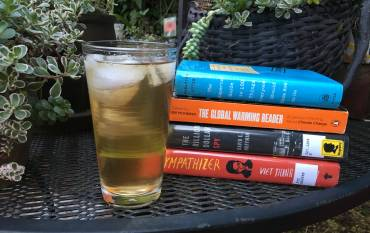 Cold drink next to a stack of books