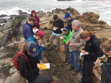 Dean Steve Graham with students on the coast
