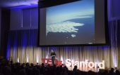 Dustin Schroeder speaks onstage at TEDxStanford