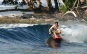 Lecturer Dan Reineman surfing