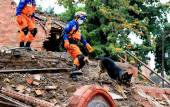 Rescue workers searching through earthquake debris in Nepal