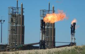 Carbon dioxide emitted from a natural gas flare at a North Dakota oil well