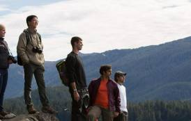 Students standing on a hilltop