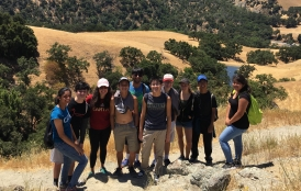 group of students with mountains in background