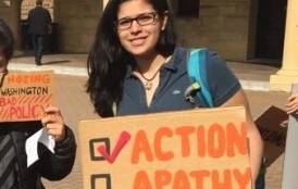 Andrea  Martinez with a taking action sign