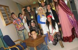 A group of people dressed up in Halloween costumes
