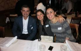 Three people at the Alumni Spaghetti Dinner