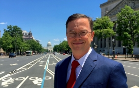 Kai Anderson with Washington, D.C, with Capitol Building in background.