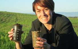 Kate Maher holding containers of soil
