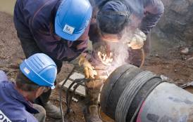 Workers install a natural gas pipeline