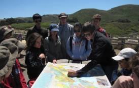 Students looking over a map