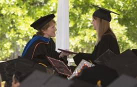 Pam Matson handing out a diploma