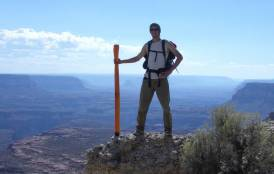 Scientist standing on top of a mountain