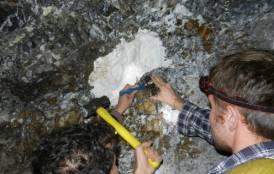 Scientist measuring Magnesite levels