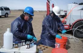 EPA staff sampling a monitoring well