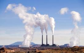 Power plant releasing carbon emissions