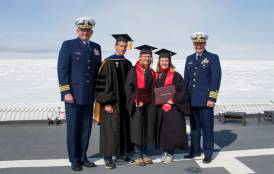 Cost Guard officers, Prof Arrigo, and two graduates on deck.