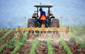 rancher applies compost to field