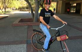 Tom Koos riding a Stanford Earth bike