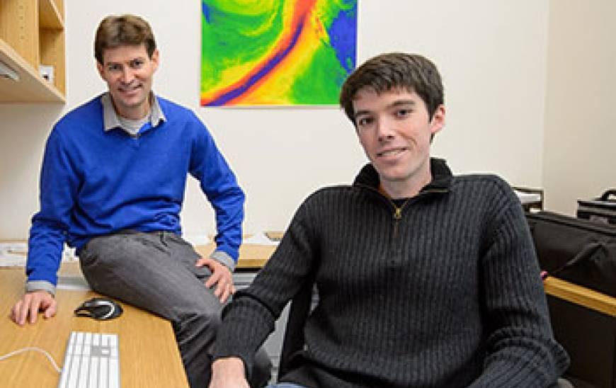 Noah Diffenbaugh and Daniel Swain sitting at a desk